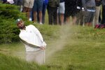 Team Europe's Jon Rahm hits from a bunker on the first hole during a practice day at the Ryder Cup at the Whistling Straits Golf Course Wednesday, Sept. 22, 2021, in Sheboygan, Wis. (AP Photo/Jeff Roberson)