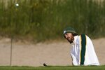 Team Europe's Tommy Fleetwood hits from a bunker on the first hole during a practice day at the Ryder Cup at the Whistling Straits Golf Course Wednesday, Sept. 22, 2021, in Sheboygan, Wis. (AP Photo/Jeff Roberson)