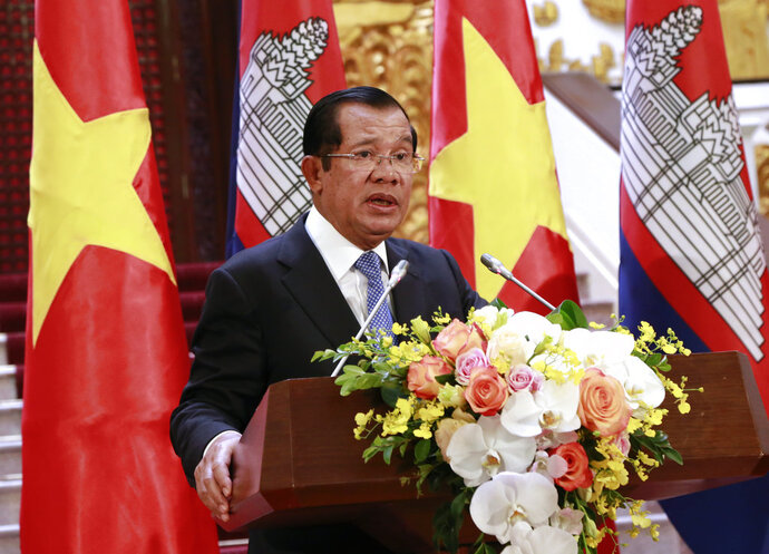 Cambodian Prime Minister Hun Sen speaks to reporters during a joint press briefing with his Vietnamese counterpart Nguyen Xuan Phuc in Hanoi, Vietnam Friday, Dec. 7, 2018. Hun Sen is on a three-day visit to Vietnam to boost ties between the two neighboring countries. (AP Photo/Tran Van Minh)