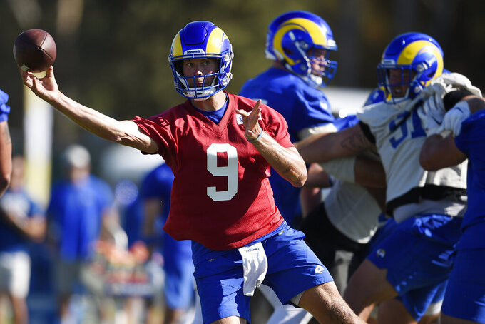 Los Angeles Rams quarterback Matthew Stafford throws a pass during an NFL football training camp practice in Irvine, Calif., Saturday, July 31, 2021. (AP Photo/Kelvin Kuo)