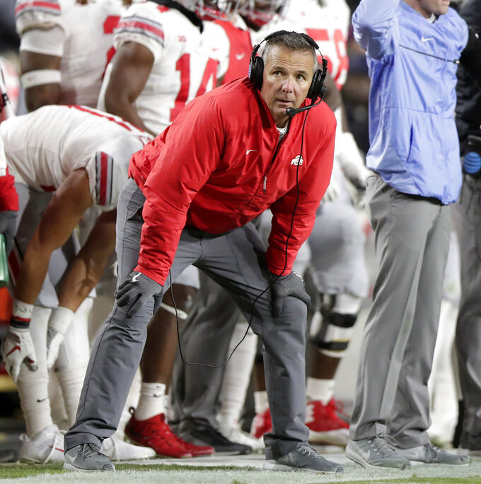 FILE - In this Oct. 20, 2018, file photo, Ohio State head coach Urban Meyer watches from he sideline during the first half of an NCAA college football game against Purdue, in West Lafayette, Ind. Retiring Ohio State coach Urban Meyer isn't easing out of the job just yet, not as long as there's one more game to win. Buckeyes players said this week that Meyer has been at the Woody Hayes Athletic Center for every practice and is fully engaged in preparations for the Rose Bowl. As usual, he's still sweating the small stuff. That kind of intensity made him one of the greatest college coaches of all time, but it also hastened his exit from the game. (AP Photo/Michael Conroy, File)