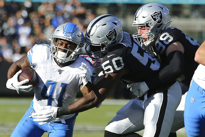Detroit Lions running back J.D. McKissic (41) runs in front of Oakland Raiders linebacker Nicholas Morrow (50) and defensive end Maxx Crosby (98) during the second half of an NFL football game in Oakland, Calif., Sunday, Nov. 3, 2019. (AP Photo/John Hefti)