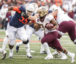 Minnesota's Mohamed Ibrahim (24) runs as Illinois' Jamal Milan (55) defends in the first half of an NCAA  college football game, Saturday, Nov. 3, 2018, in Champaign, Ill. (AP Photo/Holly Hart)