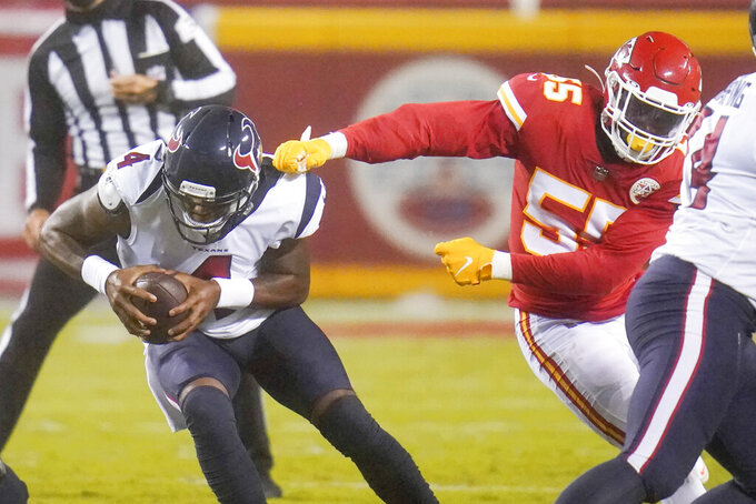 Kansas City Chiefs defensive end Frank Clark (55) gets a hand on Houston Texans quarterback Deshaun Watson (4) in the second half of an NFL football game Thursday, Sept. 10, 2020, in Kansas City, Mo. (AP Photo/Jeff Roberson)