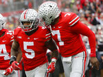 Ohio State running back Mike Weber, left, celebrates his touchdown against Michigan with teammate quarterback Dwayne Haskins during the second half of an NCAA college football game Saturday, Nov. 24, 2018, in Columbus, Ohio. Ohio State beat Michigan 62-39. (AP Photo/Jay LaPrete)