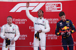 Mercedes driver Lewis Hamilton of Britain, center, celebrates on the podium after winning the Spanish Formula One race, flanked by second place Mercedes driver Valtteri Bottas of Finland, left and third place Red Bull driver Max Verstappen of the Netherland's, at the Barcelona Catalunya racetrack in Montmelo, just outside Barcelona, Spain, Sunday, May 12, 2019. (AP Photo/Manu Fernandez)