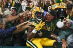 Green Bay Packers' Aaron Jones celebrates his touchdown run during the second half of an NFL football game against the Detroit Lions Monday, Sept. 20, 2021, in Green Bay, Wis. (AP Photo/Matt Ludtke)