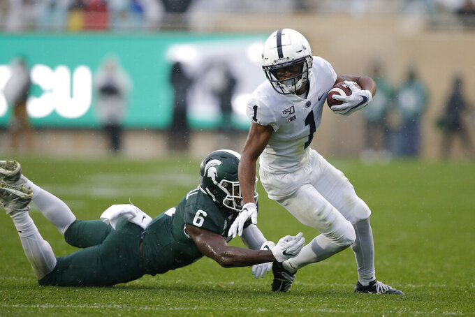 Penn State receiver KJ Hamler, right, eludes Michigan State's David Dowell (6) during the second quarter of an NCAA college football game, Saturday, Oct. 26, 2019, in East Lansing, Mich. (AP Photo/Al Goldis)