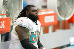 Miami Dolphins offensive guard Solomon Kindley (66) reacts from the bench as the Dolphins lose 35-0 to the Buffalo Bills, in an NFL football game, Sunday, Sept. 19, 2021, in Miami Gardens, Fla. (AP Photo/Wilfredo Lee)