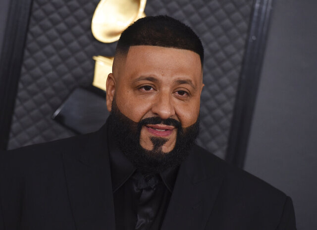 FILE - This Jan. 26, 2020 file photo shows DJ Khaled at the 62nd annual Grammy Awards in Los Angeles. Miami's hometown hero DJ Khaled surprised fans with an all-star lineup that included Rick Ross, Lil Wayne and Migos during the EA Sports Bowl at Bud Light Super Bowl Music Fest. (Photo by Jordan Strauss/Invision/AP, File)