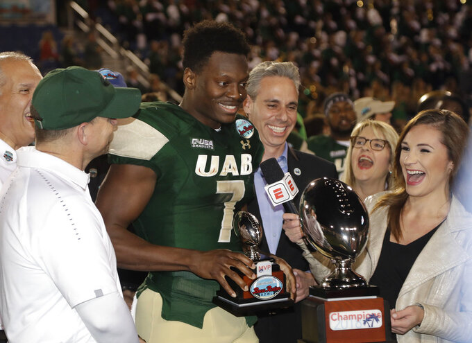 UAB wide receiver Xavier Ubosi (7) holds his trophy after being named the MVP after UAB defeated Northern Illinois in the Boca Raton Bowl NCAA college football game, Tuesday, Dec. 18, 2018, in Boca Raton, Fla. UAB won 37-13. (AP Photo/Lynne Sladky)