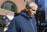 """FILE - In this March 12, 2019 file photo, William """"Rick"""" Singer founder of the Edge College & Career Network, departs federal court in Boston, after he pleaded guilty to charges in a nationwide college admissions bribery scandal. The first trial in the """"Operation Varsity Blues"""" college admissions bribery scandal will begin this week, Wednesday, Sept. 8, 2021 with the potential to shed light on investigators' tactics and brighten the spotlight on a secretive school selection process many have long complained is rigged to favor the rich. (AP Photo/Steven Senne, File)"""