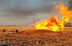 In this photo released by the Syrian official news agency SANA, Syrian firefighters extinguish the flames of a gas pipeline that hit by an explosion, between the northeastern Damascus suburbs of Adra and Dumair, in Syria Monday, Aug. 24, 2020. An explosion early on Monday struck a gas pipeline in a Damascus suburb, cutting electricity throughout Syria, state media reported, citing the country's electricity and oil ministers. (SANA via AP)