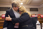 Maria Melendez, mayor of Ponce, is embraced by Commissioner Jenniffer Gonzalez before a meeting with Legislators and Mayors in San Juan, Puerto Rico, Thursday, Aug. 8, 2019. Puerto Rico Senate President Thomas Rivera Schatz, who played a key role in the successful court challenge to the swearing-in last Friday of Pedro Pierluisi after then-Gov. Ricardo Rossello resigned, publicly backed Gonzalez, Puerto Rico's representative to the U.S. Congress, to become governor. (AP Photo/Dennis M. Rivera Pichardo)