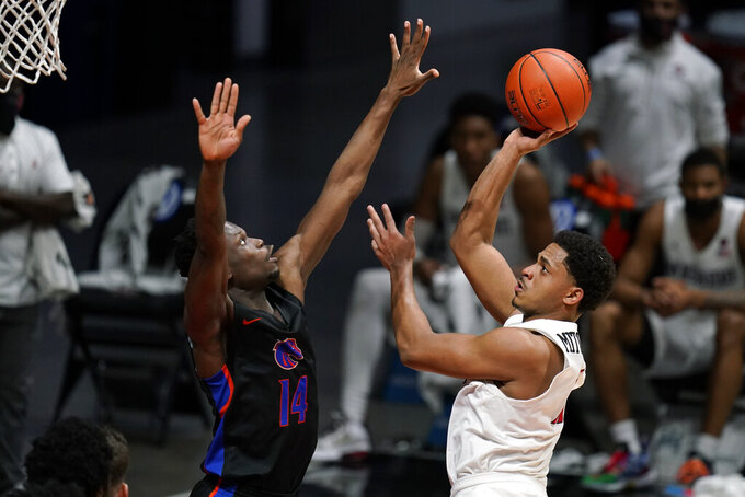 San Diego State forward Matt Mitchell (11) shoots against Boise State guard Emmanuel Akot (14) in overtime of an NCAA college basketball game Thursday, Feb. 25, 2021, in San Diego. (AP Photo/Gregory Bull)