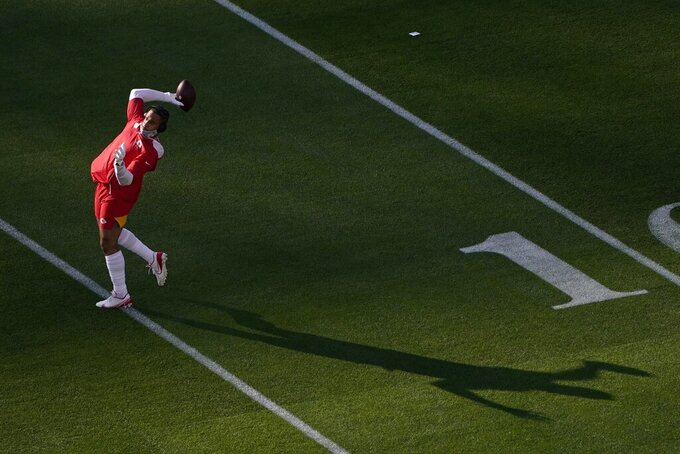 Kansas City Chiefs outside linebacker Damien Wilson throws a pass before the NFL Super Bowl 55 football game between the Kansas City Chiefs and Tampa Bay Buccaneers, Sunday, Feb. 7, 2021, in Tampa, Fla. (AP Photo/Charlie Riedel)