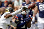 Alabama State Jacquez Payton (4) knocks a pass away from Auburn wide receiver Shedrick Jackson (11) during the first half of an NCAA football game Saturday, Sept. 11, 2021, in Auburn, Ala. (AP Photo/Butch Dill)