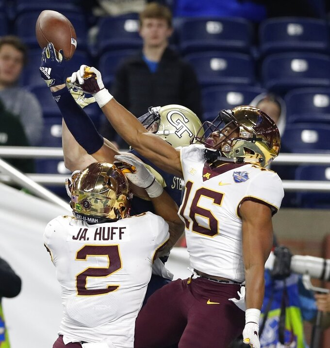 Minnesota defensive backs Jacob Huff (2) and Coney Durr (16) break up a pass intended for Georgia Tech wide receiver Brad Stewart during the second half of the Quick Lane Bowl NCAA college football game, Wednesday, Dec. 26, 2018, in Detroit. (AP Photo/Carlos Osorio)