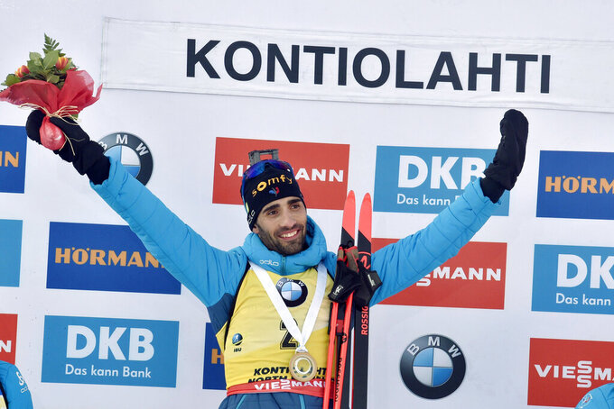 Martin Fourcade of France celebrates victory in his final competition, after winning the men's 12.5 km Pursuit competition at the IBU Biathlon World Cup in Kontiolahti, Finland, Saturday March 14, 2020.  Fourcade retired from the sport on Saturday exactly ten years after his first World Cup victory in Kontiolahti. (Jussi Nukari/Lehtikuva via AP)