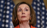 In this June 21, 2019, photo, House Speaker Nancy Pelosi of Calif., speaks with reporters at the Capitol in Washington. Pelosi says President Donald Trump's threat to begin deporting migrants if Congress doesn't quickly pass immigration legislation is 'outside the circle of civilized human behavior.' (AP Photo/J. Scott Applewhite)