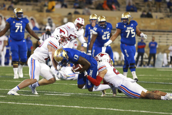 Tulsa wide receiver Josh Johnson (13) is brought down after a reception during the first half of the team's NCAA college football game against SMU in Tulsa, Okla., Saturday, Nov. 14, 2020. (AP Photo/Joey Johnson)