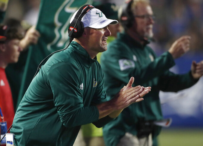 South Florida head coach Jeff Scott encourages his players in the first half of an NCAA college football game against BYU Saturday, Sept. 25, 2021, in Provo, Utah. (AP Photo/George Frey)