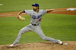 Los Angeles Dodgers relief pitcher Scott Alexander throws during the sixth inning of a baseball game in Arlington, Texas, Sunday, Aug. 30, 2020. (AP Photo/Roger Steinman)