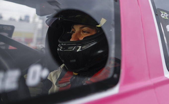Vitarti Girl's Team driver Rocio Migliore sits in her car before the team's first race at the Oscar y Juan Galvez track in Buenos Aires, Argentina, Sunday, April 4, 2021. The Vitarti Girl's Team is the first entirely female team to take part in a national racing competition in Argentina. (AP Photo/Natacha Pisarenko)
