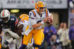 LSU quarterback Joe Burrow (9) scrambles in the first half of an NCAA college football game against Auburn in Baton Rouge, La., Saturday, Oct. 26, 2019. (AP Photo/Gerald Herbert)