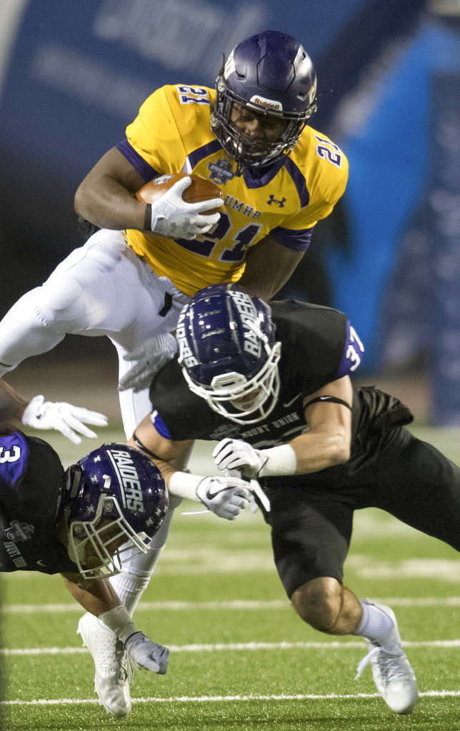 FILE - In this Dec. 15, 2017, file photo, Mary Hardin-Baylor's Markeith Miller (21) gets tackled by Mount Union's Kollyn Crenshaw (3) and Nick Brish (37) during the first half of the Amos Alonzo Stagg Bowl NCAA Division III college football championship, in Salem, Va. Markeith Miller was named to The Associated Press Division III All-America Team, Thursday, Dec. 13, 2018. (AP Photo/Lee Luther Jr., FIle)