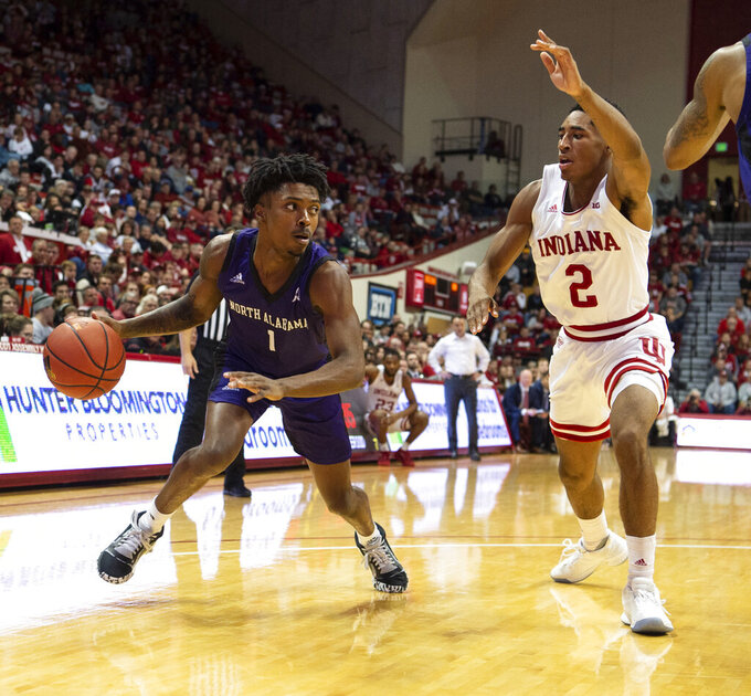 North Alabama's Tavon King (1) works the ball into the defense of Indiana's Armaan Franklin (2) during the second half of an NCAA college basketball game, Tuesday, Nov. 12, 2019, in Bloomington, Ind. Indiana won 91-65. (AP Photo/Doug McSchooler)