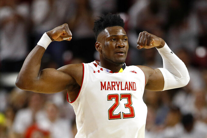 Maryland forward Bruno Fernando, of Angola, gestures after scoring in the second half of an NCAA college basketball game against Ohio State, Saturday, Feb. 23, 2019, in College Park, Md. Maryland won 72-62. (AP Photo/Patrick Semansky)