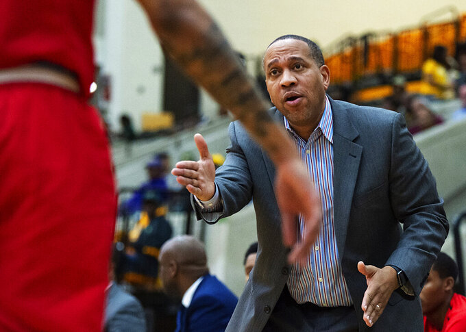 Delaware State head coach Eric Skeeters talks to one of his players during the first half of an NCAA college basketball game against Norfolk State, Saturday, Jan. 5, 2019, in Norfolk, Va. (Mike Caudill/The Virginian-Pilot via AP)
