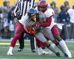 West Virginia wide receiver Ali Jennings (19) is tackled by Iowa State defensive back Arnold Azunna (4) during the first half of an NCAA college football game Saturday, Oct. 12, 2019, in Morgantown, W.Va. (AP Photo/Raymond Thompson)