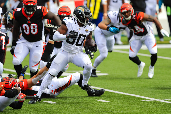 Jacksonville Jaguars running back James Robinson (30) runs against the Cincinnati Bengals in the first half of an NFL football game in Cincinnati, Sunday, Oct. 4, 2020. (AP Photo/Aaron Doster)