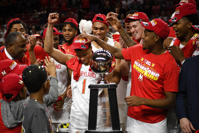 Maryland guard Anthony Cowan Jr. (1) and teammates celebrate after they won a share of the Big Ten regular season title after defeating Michigan in an NCAA college basketball game, Sunday, March 8, 2020, in College Park, Md. (AP Photo/Nick Wass)