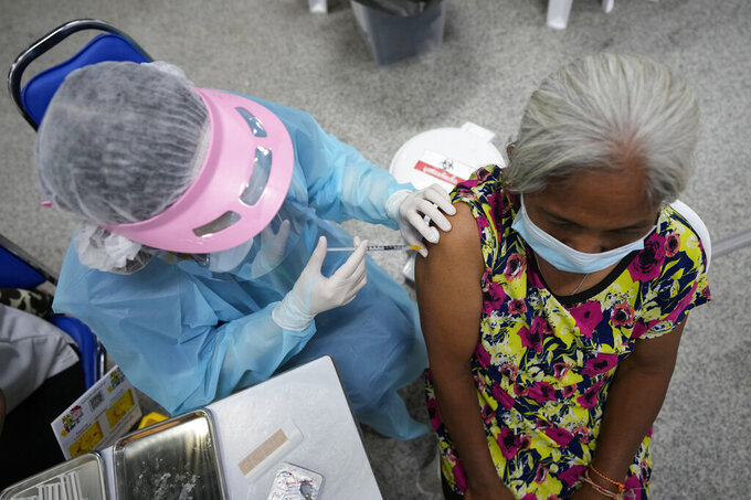 A health worker administers a shot of the AstraZeneca COVID-19 vaccine at the Central Vaccination Center in Bangkok, Thailand, Thursday, July 22, 2021. (AP Photo/Sakchai Lalit)