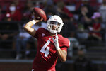 Washington State quarterback Jayden de Laura throws a pass during the first half of an NCAA college football game against Portland State, Saturday, Sept. 11, 2021, in Pullman, Wash. (AP Photo/Young Kwak)