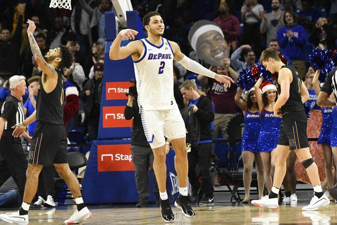 DePaul forward Jaylen Butz (2) celebrates his team's 83-78 win against Northwestern in an NCAA college basketball game, Saturday, Dec. 21, 2019, in Chicago. (AP Photo/David Banks)