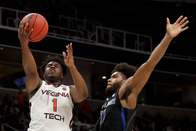 Virginia Tech guard Isaiah Wilkins shoots around Saint Louis forward Hasahn French during the first half of a first-round game in the NCAA men's college basketball tournament Friday, March 22, 2019, in San Jose, Calif. (AP Photo/Jeff Chiu)