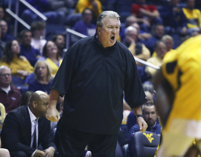 West Virginia head coach Bob Huggins yelps at referee during the second half of an NCAA college basketball game against Kansas State Monday, Feb. 18, 2019, in Morgantown, W.Va. (AP Photo/Raymond Thompson)