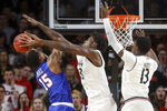 SMU's Isiaha Mike (15) shoots against Cincinnati's Nysier Brooks, center, during the first half of an NCAA college basketball game Saturday, Feb. 2, 2019, in Cincinnati. (AP Photo/John Minchillo)