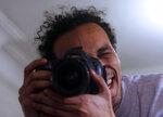 Mahmoud Abu Zaid, a photojournalist known as Shawkan, poses with his colleague's camera at his home in Cairo, Egypt, Monday, March 4, 2019. Shawkan was released after five years in prison  (AP Photo/Amr Nabil)