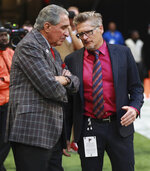 Atlanta Falcons owner Arthur Blank, left, confers with general manager Thomas Dimitroff in the final minutes of a loss to the Los Angeles Rams in an NFL football game Sunday, Oct. 20, 2019, in Atlanta. (Curtis Compton/Atlanta Journal-Constitution via AP)