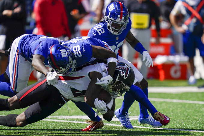 Atlanta Falcons running back Cordarrelle Patterson, below, is tackled by New York Giants safety Xavier McKinney (29) during the first half of an NFL football game, Sunday, Sept. 26, 2021, in East Rutherford, N.J. (AP Photo/Seth Wenig)