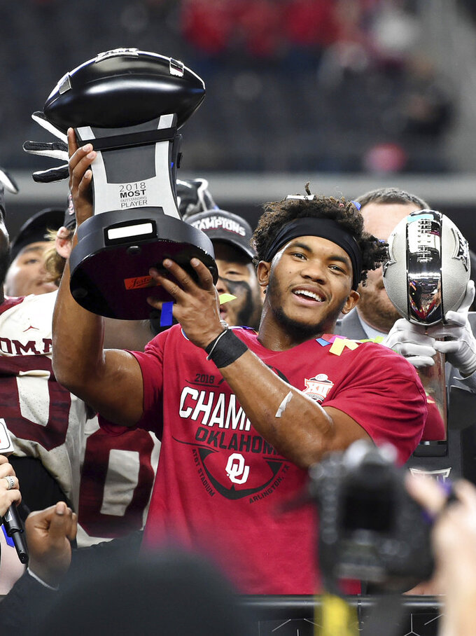 Oklahoma quarterback Kyler Murray hoists the Most Outstanding Player trophy after beating Texas 39-27 in the Big 12 Conference championship NCAA college football game on Saturday, Dec. 1, 2018, in Arlington, Texas. (AP Photo/Jeffrey McWhorter)