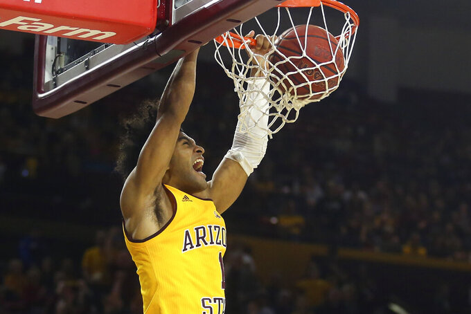 FILE - In this Feb. 8, 2020, file photo, Arizona State guard Remy Martin dunks against Southern California during the second half of an NCAA college basketball game in Tempe, Ariz. Martin opted to return to Arizona State after testing the NBA waters. (AP Photo/Ross D. Franklin, File)
