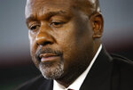 FILE - In this Dec. 6, 2018, file photo, Maryland's new head football coach Mike Locksley listens to a reporter's question after an NCAA college football news conference, in College Park, Md. Of all the things on the checklist of Maryland football coach Michael Locksley, none are more pressing than forming a bond with players who in 2018 dealt with the death of a teammate and the subsequent whirlwind of activity that transpired on and off the field. (AP Photo/Patrick Semansky, File)