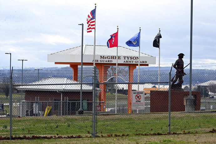 The entrance to McGhee Tyson Air National Guard Base is locked down Wednesday, Jan. 15, 2020, after reports were received of shots being fired at the facility in Alcoa, Tenn. (AP Photo/Michael Patrick)