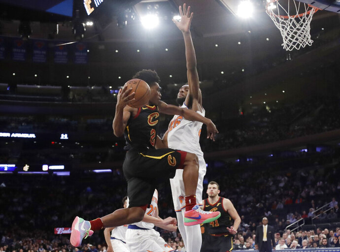 Cleveland Cavaliers' Collin Sexton (2) looks to pass the ball away from New York Knicks' Mitchell Robinson during the second half of an NBA basketball game Thursday, Feb. 28, 2019, in New York. The Cavaliers won 125-118. (AP Photo/Frank Franklin II)
